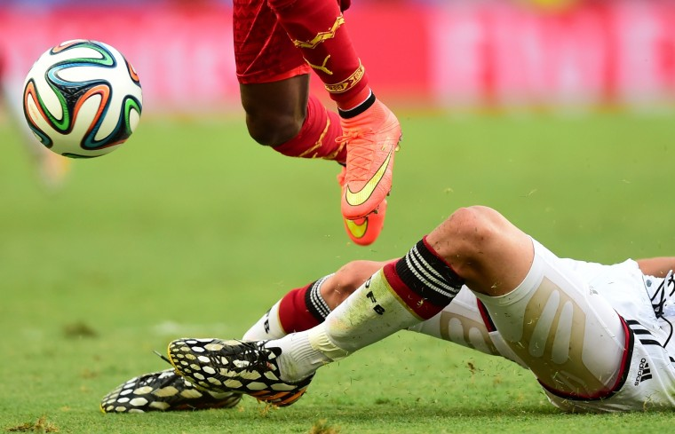Ghana's defender Harrison Afful (L) vies with Germany's defender Benedikt Hoewedes during a Group G football match between Germany and Ghana at the Castelao Stadium in Fortaleza during the 2014 FIFA World Cup. (Javier Soriano/AFP-Getty Images)