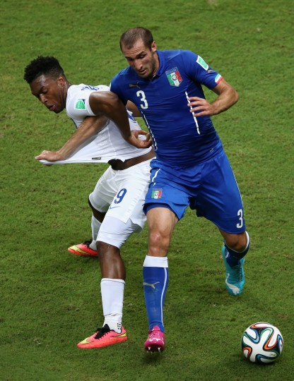 Daniel Sturridge of England and Giorgio Chiellini of Italy battle for the ball during the 2014 FIFA World Cup Brazil Group D match between England and Italy at Arena Amazonia in Manaus, Brazil. (Warren Little/Getty Images)