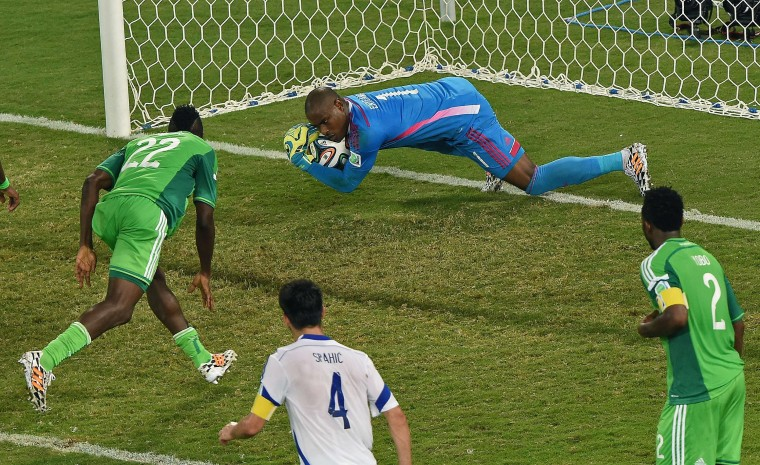 Nigeria's goalkeeper Vincent Enyeama (C) makes a save during the Group F football match between Nigeria and Bosnia-Hercegovina at the Pantanal Arena in Cuiaba during the 2014 FIFA World Cup. (Luis Acosta/AFP-Getty Images)
