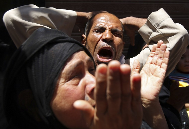 Relatives and families of members of the Muslim Brotherhood and supporters of ousted Egyptian President Mohamed Mursi react outside a court in Minya, south of Cairo, after the sentences of Muslim Brotherhood leader Mohamed Badie and his supporters were announced. An Egyptian court confirmed death sentences against the leader of the outlawed Muslim Brotherhood and at least 182 of his supporters, judicial sources at the court told Reuters. The court's decision came two months after it referred the case against the Brotherhood's general guide Mohamed Badie and hundreds of others to the state's highest religious authority, the Mufti, the first step towards imposing a death sentence. (Mohamed Abd El Ghany/Reuters)