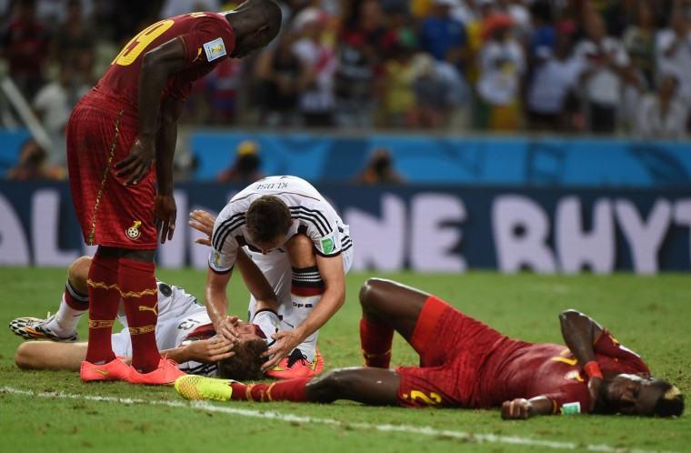 Ghana's defender John Boye (R) and Germany's forward Thomas Mueller react after colliding during a Group G football match between Germany and Ghana at the Castelao Stadium in Fortaleza during the 2014 FIFA World Cup. The game ended with a draw 2-2. (Patrik Stollarz/AFP-Getty Images)