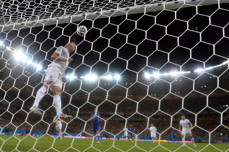 England's defender Phil Jagielka saves a goal during a Group D football match between England and Italy at the Amazonia Arena in Manaus during the 2014 FIFA World Cup. (Ben Stansall/AFP-Getty Images)