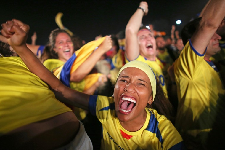 Ecuadorian soccer fans react to their team scoring against the Honduras team as they watch on the screen setup at the Word Cup FIFA Fan Fest during on Copacabana beach in Rio de Janeiro, Brazil. (Joe Raedle/Getty Images)