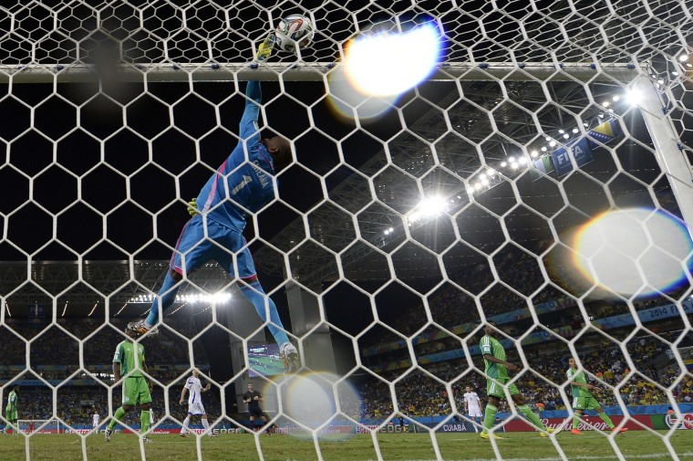 Nigeria's goalkeeper Vincent Enyeama jumps for the ball during the Group F football match between Nigeria and Bosnia-Hercegovina at the Pantanal Arena in Cuiaba during the 2014 FIFA World Cup. (Juan Barreto/AFP-Getty Images)