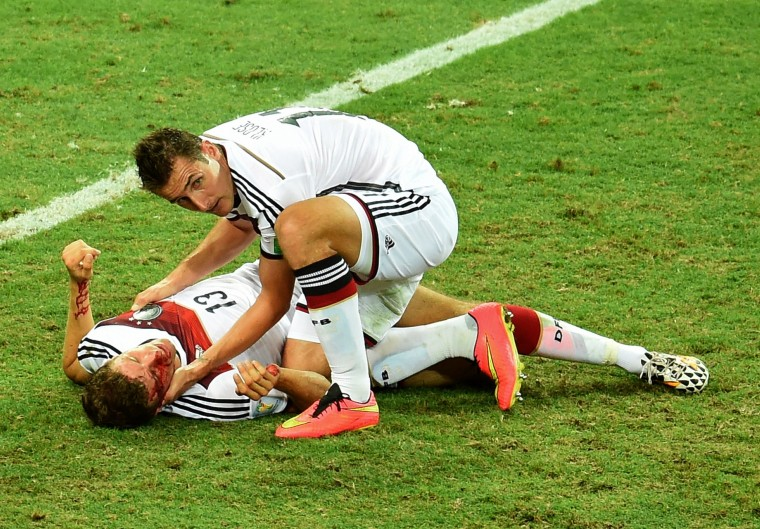 Germany's forward Miroslav Klose (R) checks Germany's forward Thomas Mueller after a collision during a Group G football match between Germany and Ghana at the Castelao Stadium in Fortaleza during the 2014 FIFA World Cup. The game ended with a draw 2-2. (Emmanuel Dunand/AFP-Getty Images)