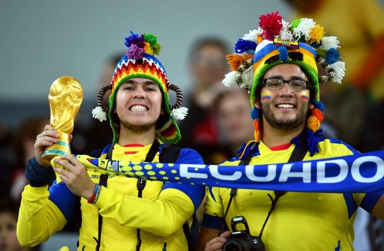 Ecuador fans cheer during the 2014 FIFA World Cup Brazil Group E match between Honduras and Ecuador at Arena da Baixadav in Curitiba, Brazil. (Matthias Hangst/Getty Images)