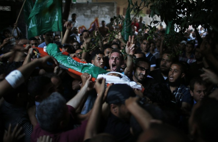 Palestinians carry the body of seven-year-old Ali Al-Awor during his funeral in Beit Lahiya in the northern Gaza Strip. The boy died the previous day from a wound he suffered in an Israeli air strike earlier in the week, Palestinian medics said. The army said it had targeted militants in the Gaza Strip planning attacks on Israel. (Mohammed Salem/Reuters)