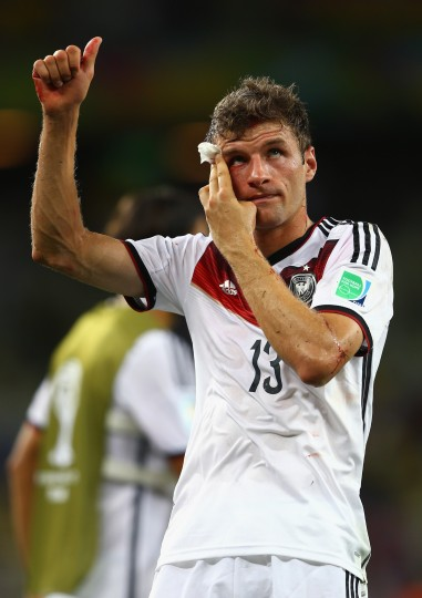Thomas Mueller of Germany acknowledges the fans after an injury late in the match during the 2014 FIFA World Cup Brazil Group G match between Germany and Ghana at Castelao in Fortaleza, Brazil. (Michael Steele/Getty Images)