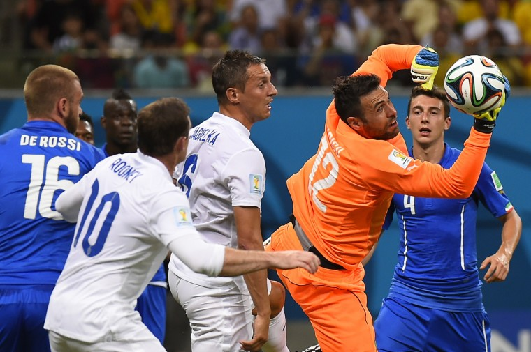 Italy's goalkeeper Salvatore Sirigu (2R) saves the ball during a Group D football match between England and Italy at the Amazonia Arena in Manaus during the 2014 FIFA World Cup. (Fabrice Coffrini/AFP-Getty Images)