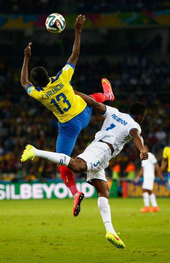 Enner Valencia of Ecuador collides with Maynor Figueroa of Honduras during the 2014 FIFA World Cup Brazil Group E match between Honduras and Ecuador at Arena da Baixada in Curitiba, Brazil. (Clive Rose/Getty Images)