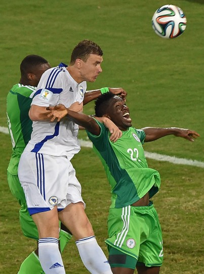 Bosnia-Hercegovina's forward Edin Dzeko jumps to head the ball with Nigeria's defender Kenneth Omeruo (R) during the Group F football match between Nigeria and Bosnia-Hercegovina at the Pantanal Arena in Cuiaba during the 2014 FIFA World Cup. (Luis Acosta/AFP-Getty Images)