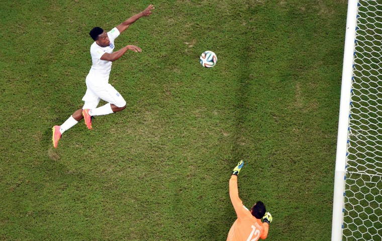 England forward Daniel Welbeck (L) tries to score a goal as Italy's goalkeeper Salvatore Sirigu defends during a Group D football match between England and Italy at the Amazonia Arena in Manaus during the 2014 FIFA World Cup. (Francois Xavier Marit/AFP-Getty Images)