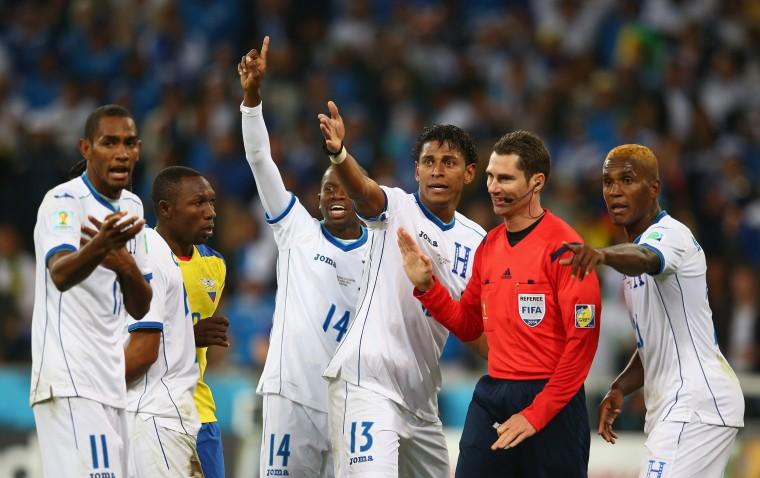 Honduras appeal to referee Benjamin Williams after a call during the 2014 FIFA World Cup Brazil Group E match between Honduras and Ecuador at Arena da Baixada in Curitiba, Brazil. (Julian Finney/Getty Images)