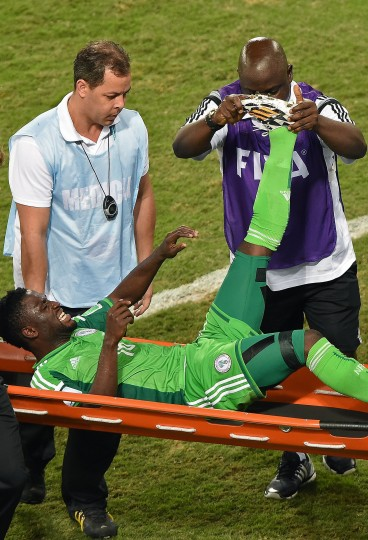 Nigeria's forward Michael Babatunde is carried off the pitch after being injured during the Group F football match between Nigeria and Bosnia-Hercegovina at the Pantanal Arena in Cuiaba during the 2014 FIFA World Cup. (Luis Acosta/AFP-Getty Images)