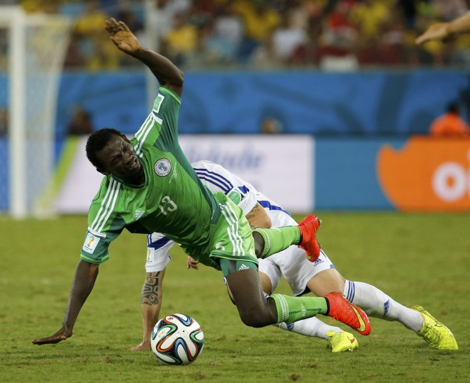 Nigeria's Juwon Oshaniwa (L) is fouled by Bosnia's Muhamed Besic during their 2014 World Cup Group F soccer match at the Pantanal arena in Cuiaba. (Eric Gaillard/Reuters)
