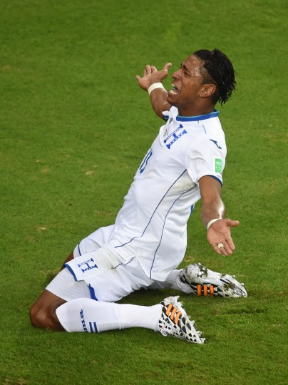Honduras' forward Carlo Costly celebrates after scoring during a Group E football match between Honduras and Ecuador at the Baixada Arena in Curitiba during the 2014 FIFA World Cup. (Christophe Simon/AFP-Getty Images)
