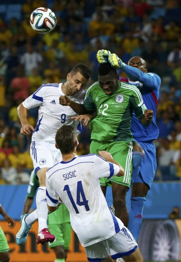 Nigeria's Vincent Enyeama (R) knocks the ball away during their 2014 World Cup Group F soccer match against Bosnia at the Pantanal arena in Cuiaba. Also seen are Bosnia's Vedad Ibisevic (top L) and Tino Sven Susic (bottom) and Nigeria's Kenneth Omeruo. (Michael Dalder/reuters)