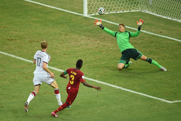 Ghana's forward and captain Asamoah Gyan (C) scores during a Group G football match between Germany and Ghana at the Castelao Stadium in Fortaleza during the 2014 FIFA World Cup. (Emmanuel Dunand/AFP-Getty Images)
