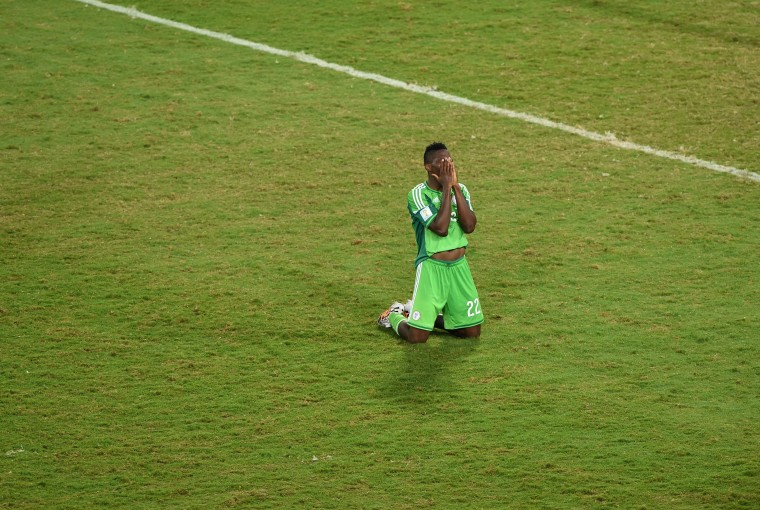 Nigeria's defender Kenneth Omeruo reacts at the end of the Group F football match between Nigeria and Bosnia-Hercegovina at the Pantanal Arena in Cuiaba during the 2014 FIFA World Cup on June 21, 2014. Nigeria won 1-0. (Luis Acosta/AFP-Getty Images)