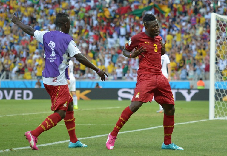 Ghana's forward and captain Asamoah Gyan (R) celebrates after scoring during a Group G football match between Germany and Ghana at the Castelao Stadium in Fortaleza during the 2014 FIFA World Cup. (Carl De Souza/AFP-Getty Images)