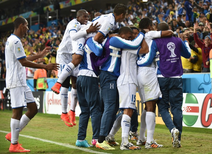 Honduras' players celebrate after Honduras' forward Carlo Costly (2ndR) scored during a Group E football match between Honduras and Ecuador at the Baixada Arena in Curitiba during the 2014 FIFA World Cup. (Rodrigo Arangua/AFP-Getty Images)