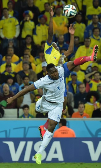 Honduras' defender Maynor Figueroa vies with an Ecuador's opponent during a Group E football match between Honduras and Ecuador at the Baixada Arena in Curitiba during the 2014 FIFA World Cup. (Gabriel Bouys/AFP-Getty Images)