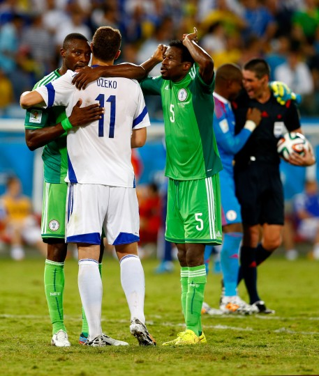 Shola Ameobi of Nigeria hugs Edin Dzeko of Bosnia and Herzegovina after a 1-0 Nigeria win during the 2014 FIFA World Cup Group F match between Nigeria and Bosnia-Herzegovina at Arena Pantanal in Cuiaba, Brazil. (Matthew Lewis/Getty Images)