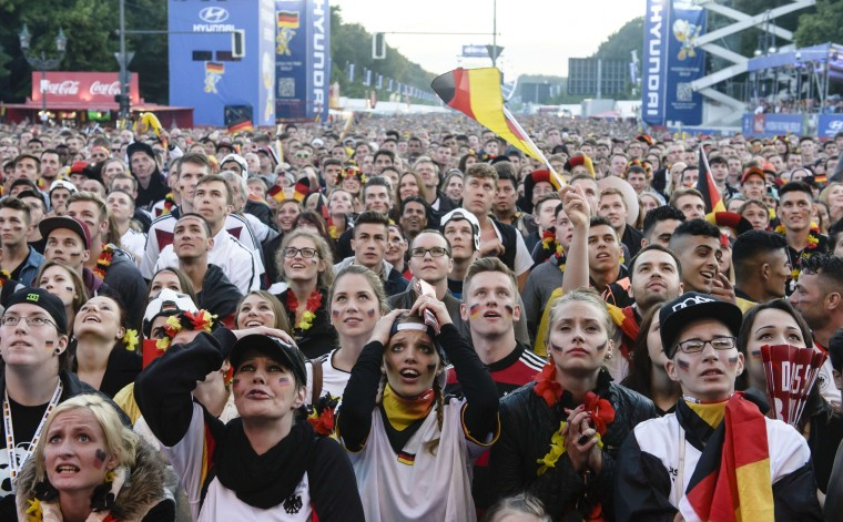 German fans react near the Brandenburg Gate in Berlin, Germany, as they watch the FIFA World Cup 2014 group G football match Germany vs Ghana played in Fortaleza, Brazil. (Clemens Bilan/AFP-Getty Images)