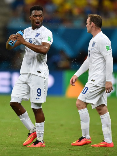 England's forward Daniel Sturridge (L) sprays water on his face during a Group D football match between England and Italy at the Amazonia Arena in Manaus during the 2014 FIFA World Cup. (Ben Stansall/AFP/Getty Images)