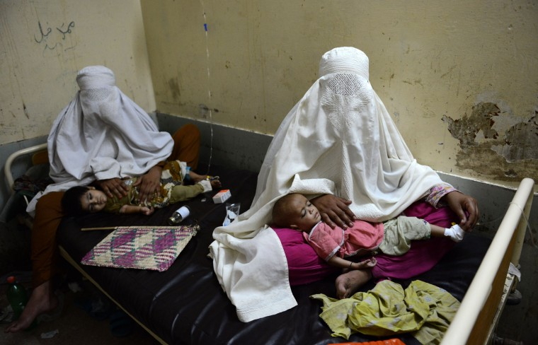 Internally Displaced Pakistan women from the North Waziristan tribal region sit with their sick children at the Women and Children Hospital in Bannu. Pakistani helicopter gunships pounded militant targets in the country's northwest, killing up to 30 rebels as the number of civilians fleeing an expected ground offensive passed 200,000. (A Majeed/AFP-Getty Images)