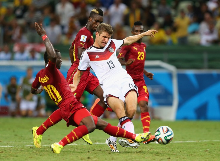 Kwadwo Asamoah of Ghana tackles Thomas Mueller of Germany during the 2014 FIFA World Cup Brazil Group G match between Germany and Ghana at Castelao in Fortaleza, Brazil. (Martin Rose/Getty Images)