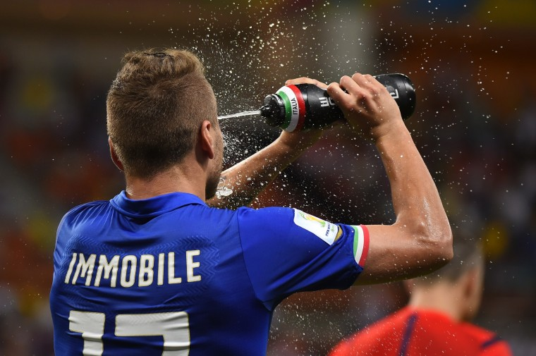 Italy's forward Ciro Immobile sprays water on his face after they won their Group D football match between England and Italy at the Amazonia Arena in Manaus during the 2014 FIFA World Cup. (Fabrice Coffrini/AFP-Getty Images)