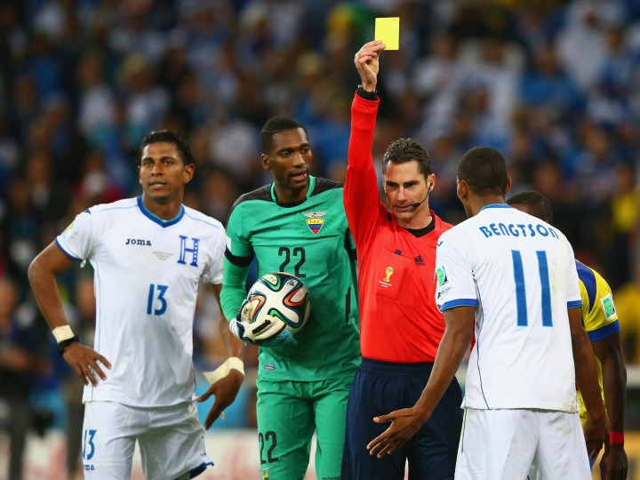 Jerry Bengtson of Honduras is shown a yellow card by referee Benjamin Williams during the 2014 FIFA World Cup Brazil Group E match between Honduras and Ecuador at Arena da Baixada in Curitiba, Brazil. (Julian Finney/Getty Images)