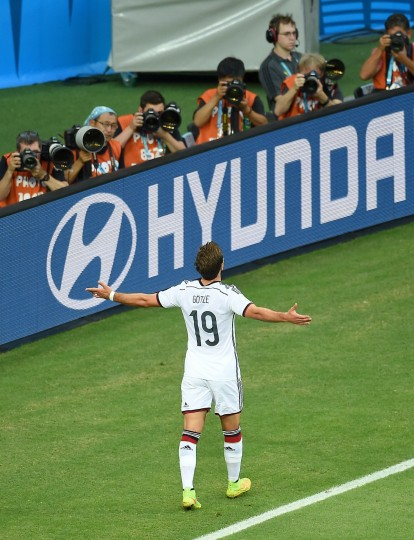 Germany's forward Mario Goetze celebrates after scoring during a Group G football match between Germany and Ghana at the Castelao Stadium in Fortaleza during the 2014 FIFA World Cup. (Emmanuel Dunand/AFP-Getty Images)