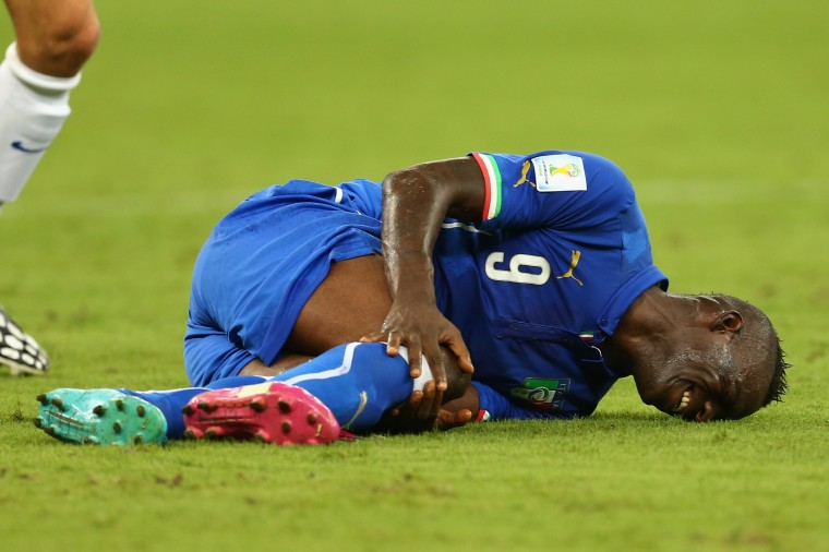 Mario Balotelli of Italy lies on the field after a tackle during the 2014 FIFA World Cup Brazil Group D match between England and Italy at Arena Amazonia in Manaus, Brazil. (Elsa/Getty Images)