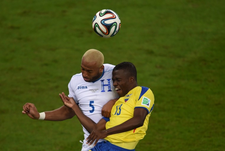 Honduras' defender Victor Bernardez (L) vies with Ecuador's forward Enner Valencia during a Group E football match between Honduras and Ecuador at the Baixada Arena in Curitiba during the 2014 FIFA World Cup. (Christophe Simon/AFP-Getty Images)