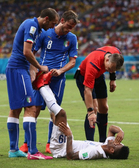 Giorgio Chiellini (L) and Claudio Marchisio of Italy help Raheem Sterling of England stretch during the 2014 FIFA World Cup Brazil Group D match between England and Italy at Arena Amazonia on June 14, 2014 in Manaus, Brazil. (Adam Pretty/Getty Images)