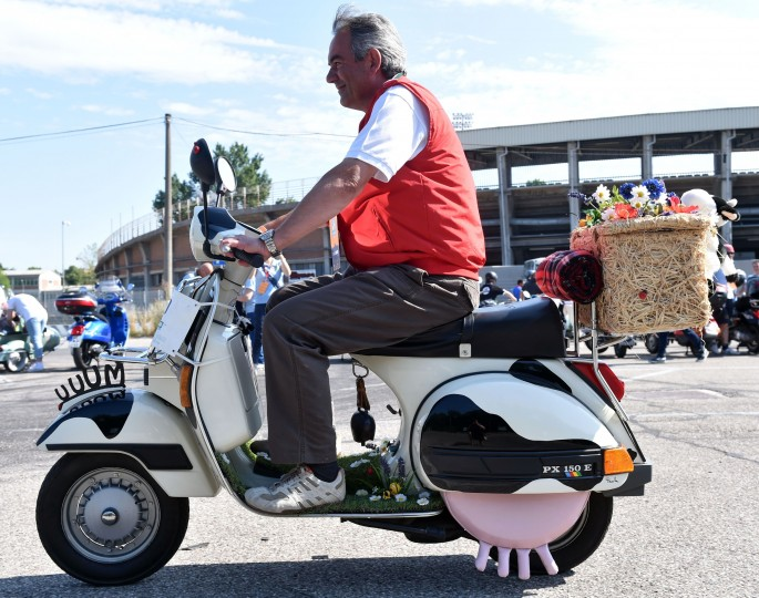 A Vespa club member arrives in Mantova during Vespa World Days. Vespa lovers from all over Europe and further afield gather together for the largest and best-known rally of its kind worldwide. (Alberto Lingria/AFP-Getty Images)