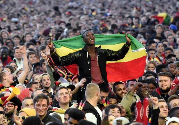 A fan of Ghana holds a flag during a public viewing event of their 2014 World Cup soccer match against Germany in Hamburg. (Fabian Bimmer/Reuters)