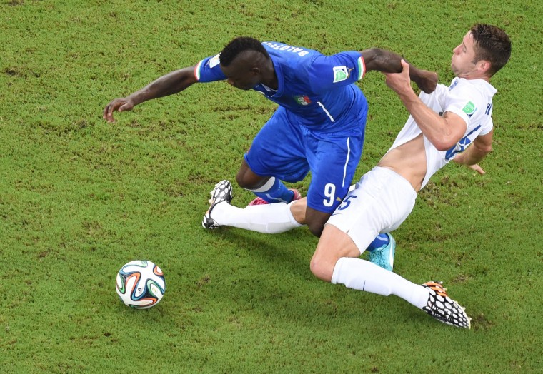 Italy's forward Mario Balotelli (L) and England's defender Gary Cahill vie for the ball during a Group D football match between England and Italy at the Amazonia Arena in Manaus during the 2014 FIFA World Cup. (Francois Xavier Marit/Pool/AFP-Getty Images)
