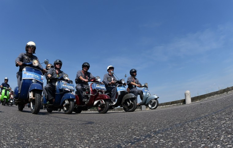 Vespa riders on a road oin Mantova during Vespa World Days. Vespa lovers from all over Europe and further afield gather together for the largest and best-known rally of its kind worldwide. (Alberto Lingria/AFP-Getty Images)