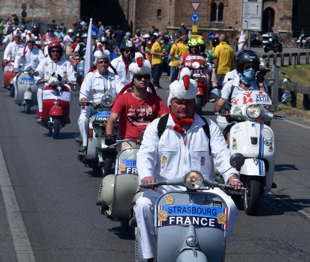 French Vespa riders parade in front of San Giorgio Castle in Mantova during Vespa World Days. Vespa lovers from all over Europe and further afield gather together for the largest and best-known rally of its kind worldwide. (Alberto Lingria/AFP-Getty Images)