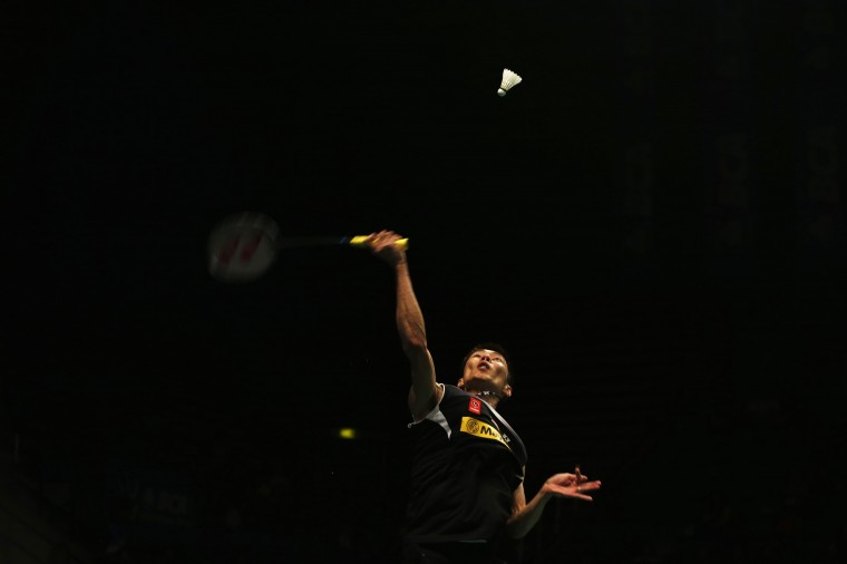 Malaysia's Lee Chong Wei returns a shot to Japan's Kenichi Tago during their men's singles semi-final match at the Indonesia Open badminton championship in Jakarta. (Beawiharta/Reuters)
