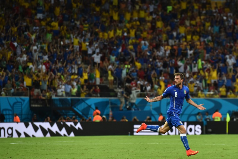 Italy's midfielder Claudio Marchisio celebrates after scoring during a Group D football match between England and Italy at the Amazonia Arena in Manaus during the 2014 FIFA World Cup. (Ben Stnsall/AFP-Getty Images ORG XMIT: 491676919