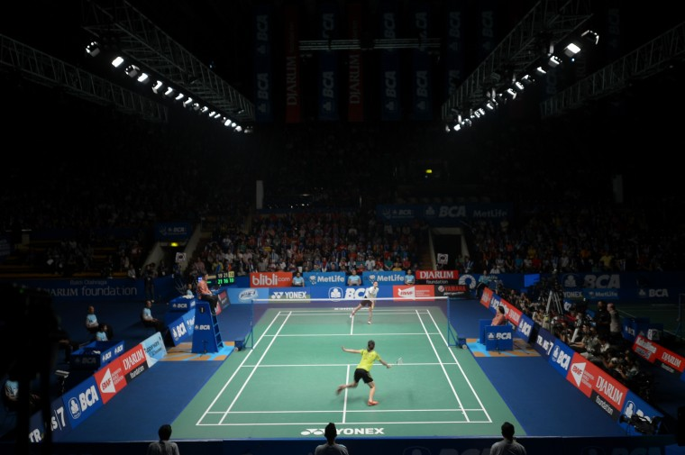 Ratchanok Intanon (white) of Thailand plays against Wang Shixian (yellow) of China at the Indonesia Open badminton championship women singles semi-final match in Jakarta. Intanon won 19-21, 21-16, 21-13. (Adek Berry/AFP-Getty Images)