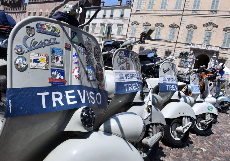 Vespas parked on Sordello Square in Mantova during Vespa World Days. Vespa lovers from all over Europe and further afield gather together for the largest and best-known rally of its kind worldwide. (Alberto Lingria/AFP-Getty Images)