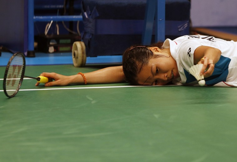Thailand's Ratchanok Intanon reacts after falling during her women's singles semi-final match with China's Wang Shixian at the Indonesia Open badminton championship in Jakarta (Beawiharta/Reuters)