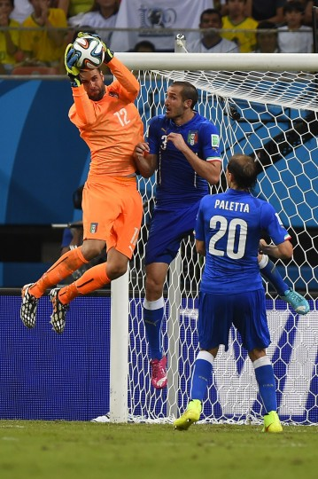 Italy's goalkeeper Salvatore Sirigu (L) saves the ball as Italy's defender Giorgio Chiellini (C) and Italy's defender Gabriel Paletta watch on during a Group D football match between England and Italy at the Amazonia Arena in Manaus during the 2014 FIFA World Cup. (Fabrice Coffrini/AFP-Getty Images)