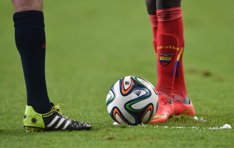 An Ecuador's player gets ready to take a free kick during a Group E football match between Honduras and Ecuador at the Baixada Arena in Curitiba during the 2014 FIFA World Cup. (Rodrigo Arangua/AFP-Getty Images)