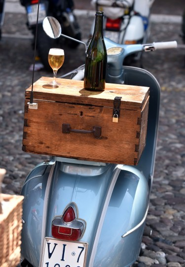 A Vespa and some wine parked on Sordello Square in Mantova during Vespa World Days. Vespa lovers from all over Europe and further afield gather together for the largest and best-known rally of its kind worldwide. (Alberto Lingria/AFP-Getty Images)